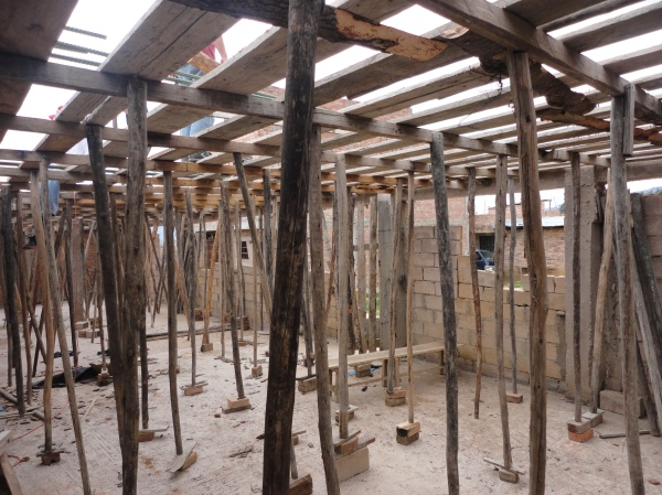 Before we pour the cement to make the ceiling/floor of the second story, we level it and support it with these wooden poles.